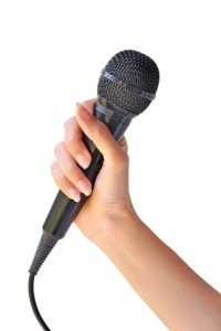 Woman with microphone to speak